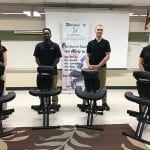 Some of our massage team next to massage chairs